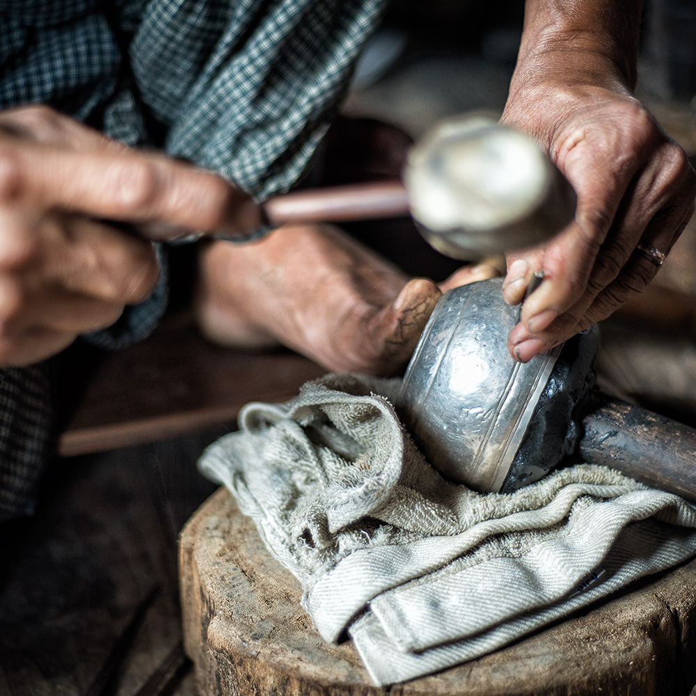 man cleaning pottery