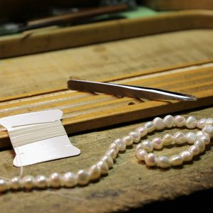 pearl necklace of wooden table